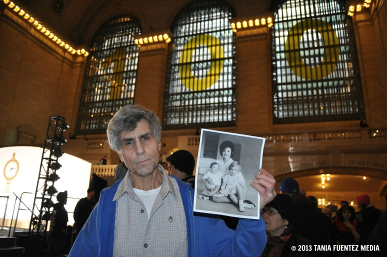 QUEENS RESIDENT GARY WEXLER HOLDS A KENNEDY PHOTO IN GRAND CENTRAL'S 100TH BIRTHDAY CELEBARTION