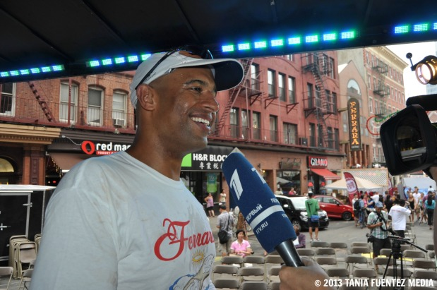 YASIR SALEM, 36, SPEAKS WITH REPORTERS AFTER WINNING FERRARA'S CANNOLI-EATING CONTEST